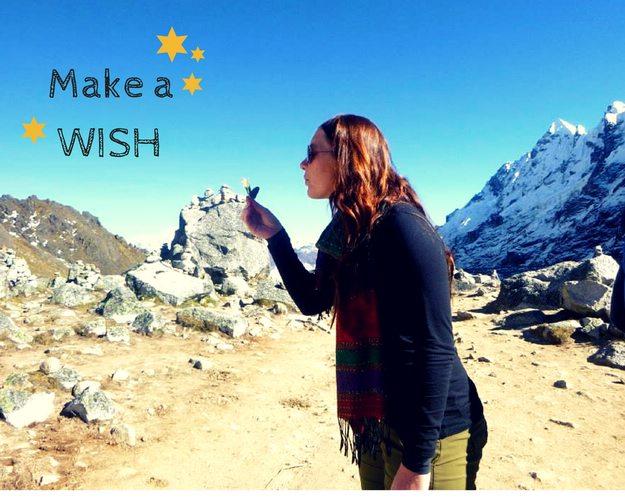 Making a wish at the top of Salkantay