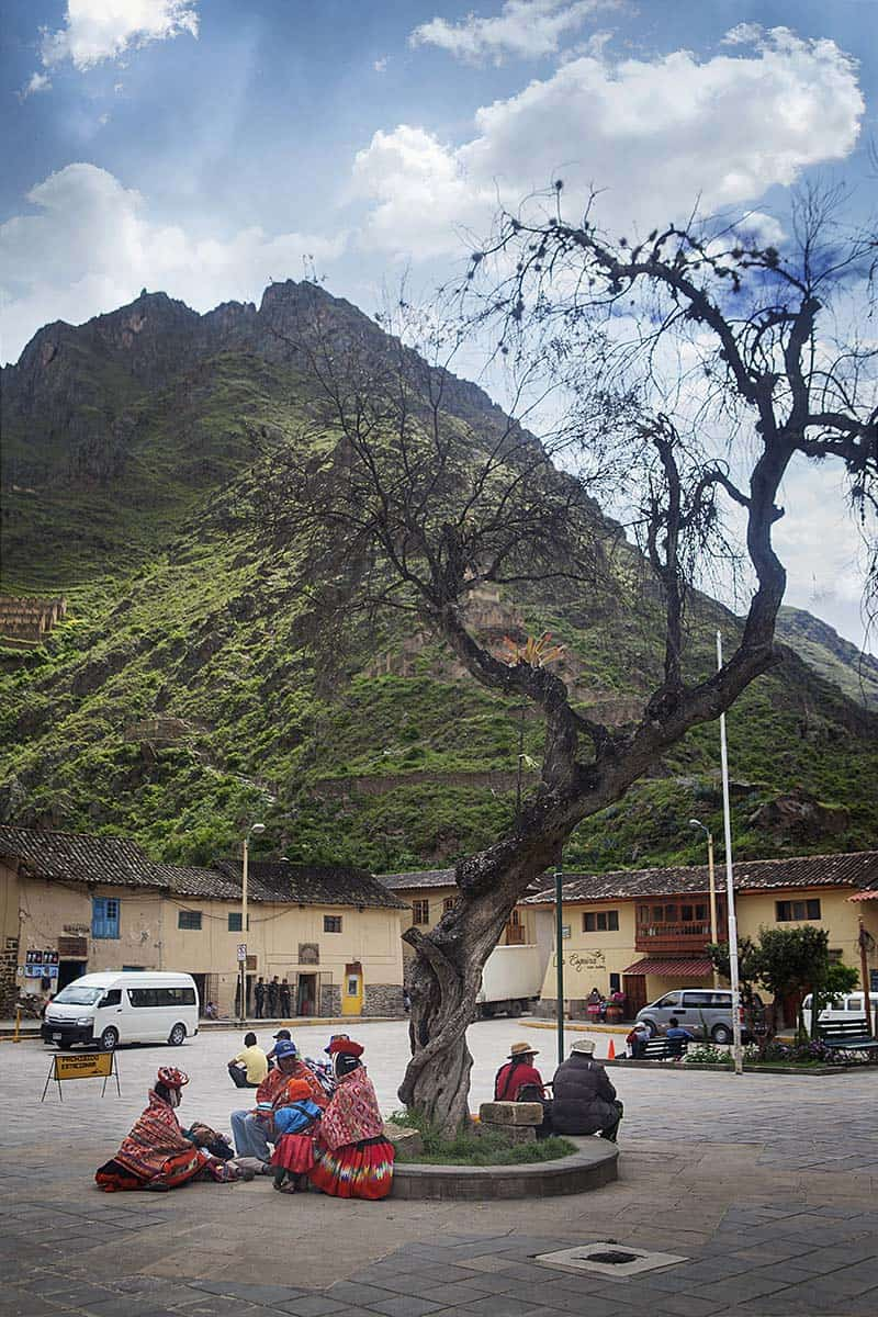 Local people sitting in a plaza in Ollantaytambo.