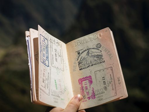 holding an open passport with south america stamps in it