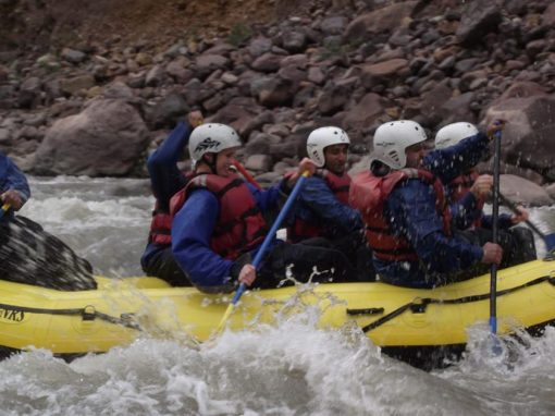 A group of adventurers white water rafting on the Urubamba River in the Sacred Valley.