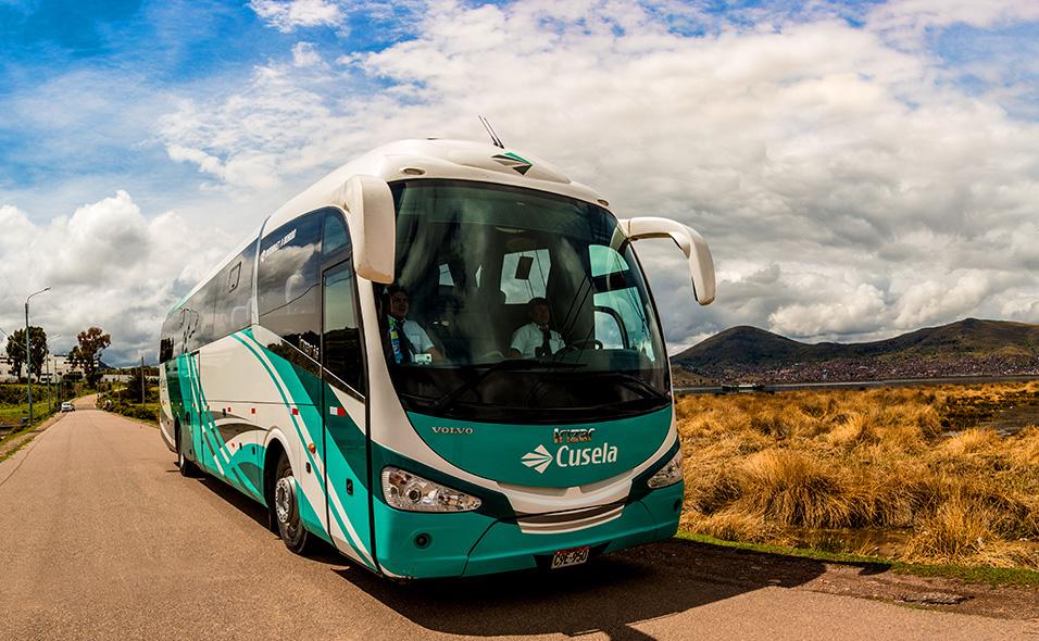 A Cusela bus on the road.