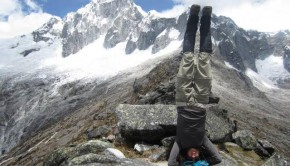 Liz W. performs a head stand on the edge of a mountain in the Cordillera Blanca, Peru