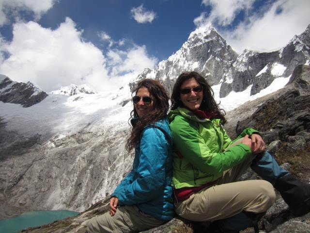 Liz and her sister sit high in the mountains while trekking in Huaraz, Peru