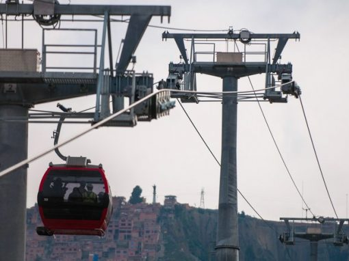A cable car traveling between La Paz and El Alto, part of the Mi Teleferico system.