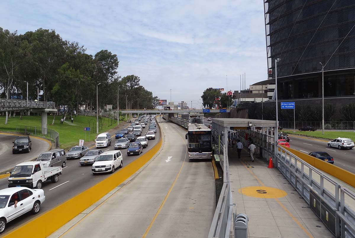 Car and bus lanes of traffic along the Via Expresa highway in Lima.