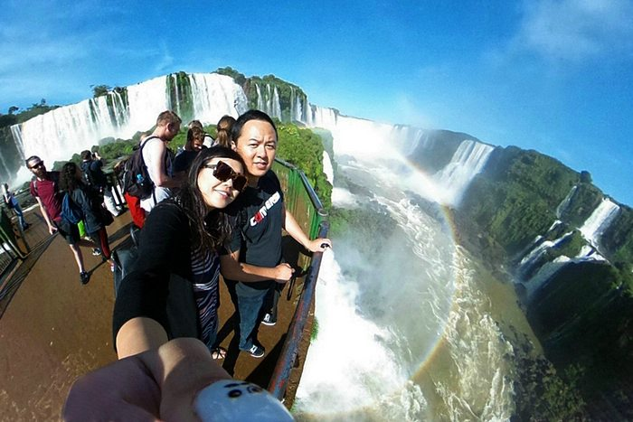 travelers at Iguazu Falls in Argentina