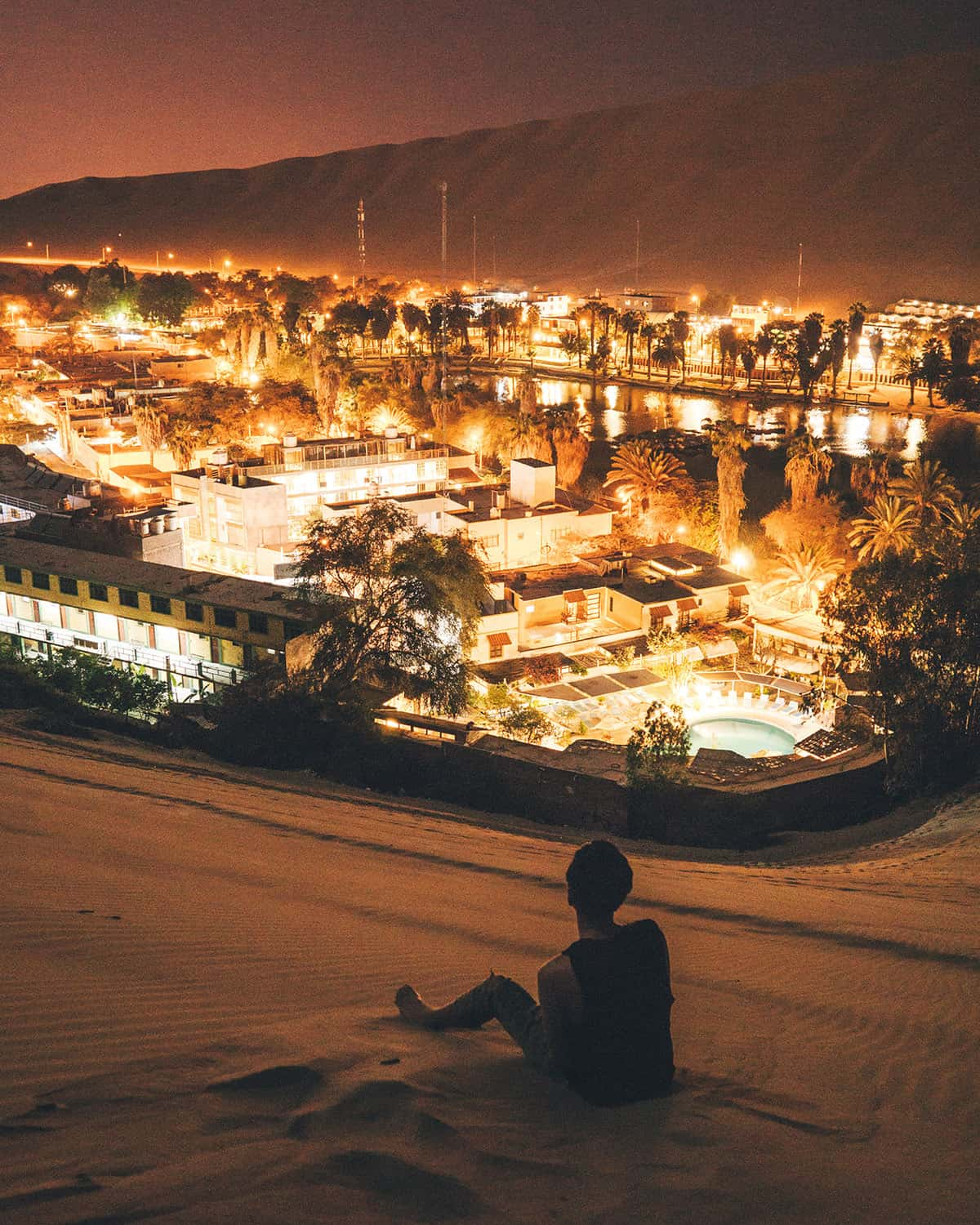 Bright lights of the Huacachina desert oasis at night