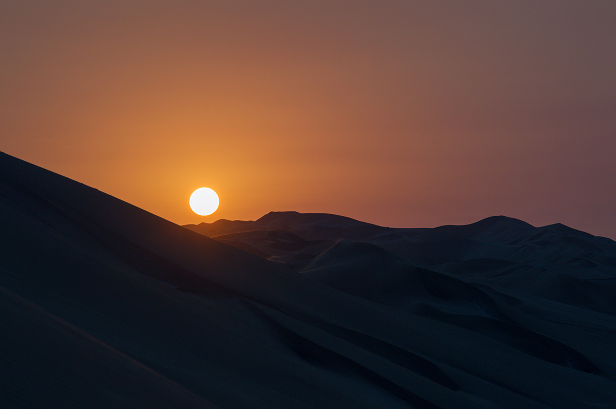 Sun setting over the Ica desert near Huacachina