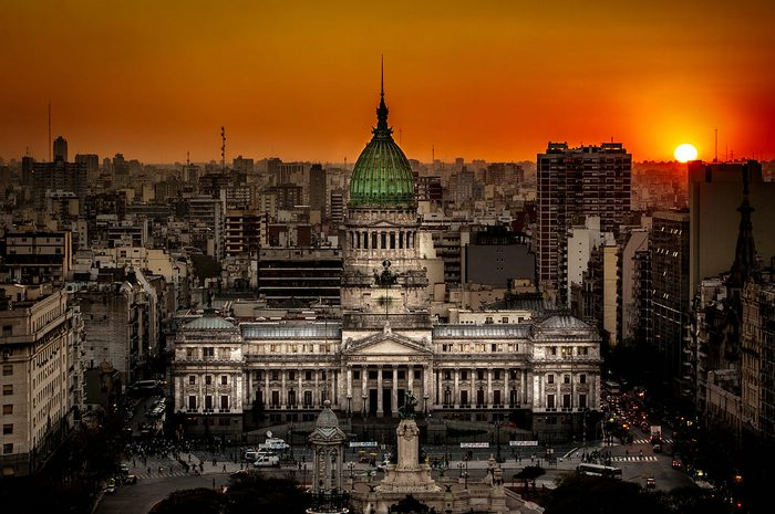 Sun setting over congress building buenos aires