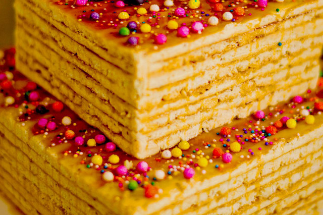 An upclose shot of turron de dona pepa. Srtacked in thin layers with big sprinklers on top.