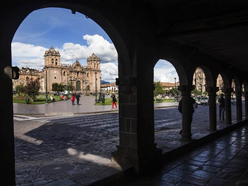 View of the main plaza in Cusco through silhouette arches