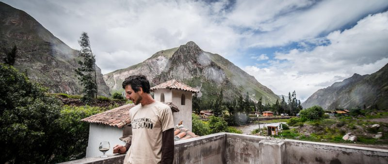A man enjoying a beer on the rooftop at Cerveceria del Valle Sagrado.