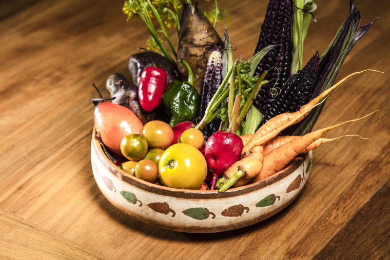 A bowl of fresh vegetables and fruits at Chuncho restaurant in the Sacred Valley.