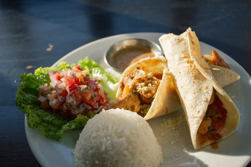 A plate of fajitas with rice and salsa at Hearts Cafe in the Sacred Valley.
