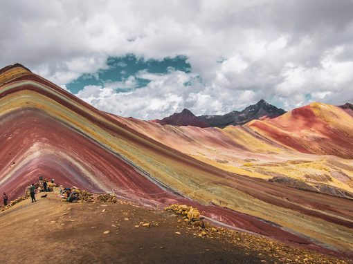 Panoramic view of the multi-colored Rainbow Mountain and the nearby Red Valley in Cusco.