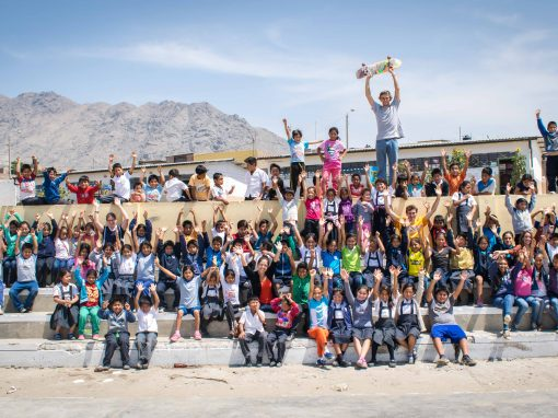 Kids posing at a Concrete Jungle Foundation project.