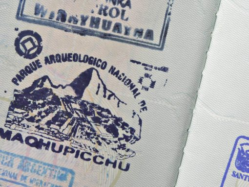 A blue passport stamp for Machu Picchu with an illustration of the ruins.