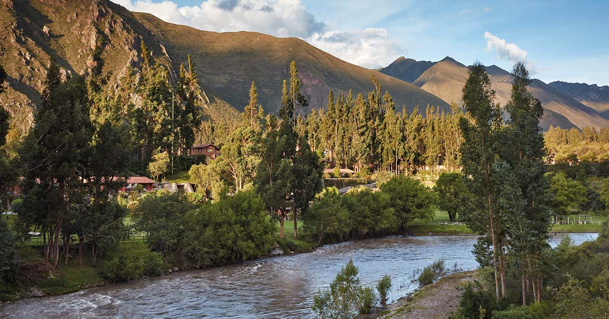 River and mountain views at the Sacred Valley Luxury Hotel Belmond Rio Sagrado Hotel on a sunny day