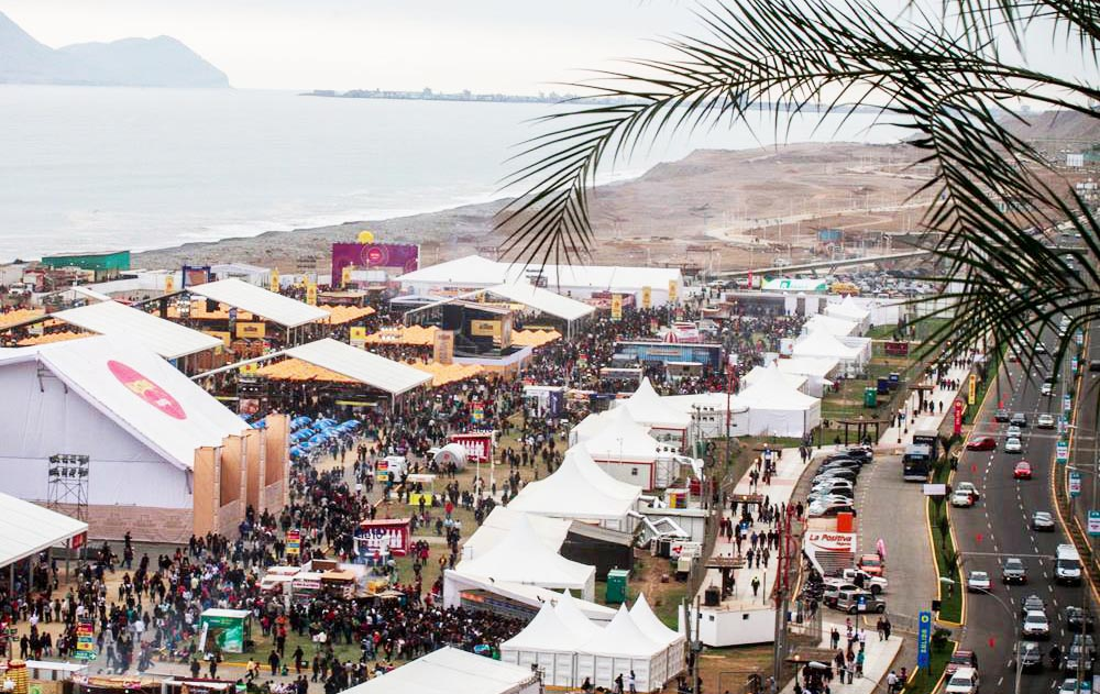 White tents and crowds of attendees for the Mistura Food Festival on the Costa Verde of Lima on a cloudy day
