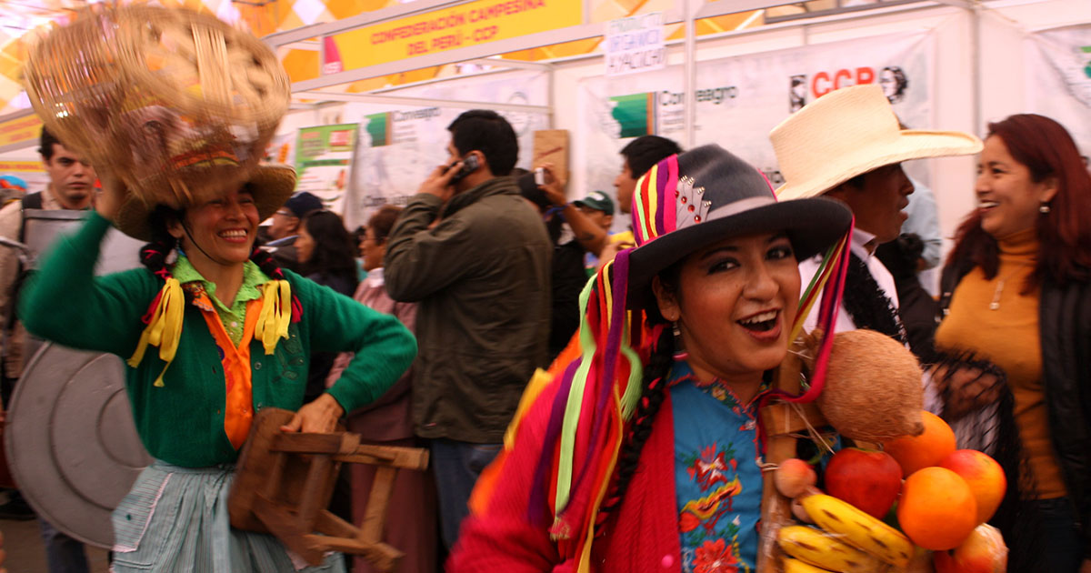 Woman holding Peruvian fruits at the popular Mistura Food Festival, South America's largest annual gastronomic event