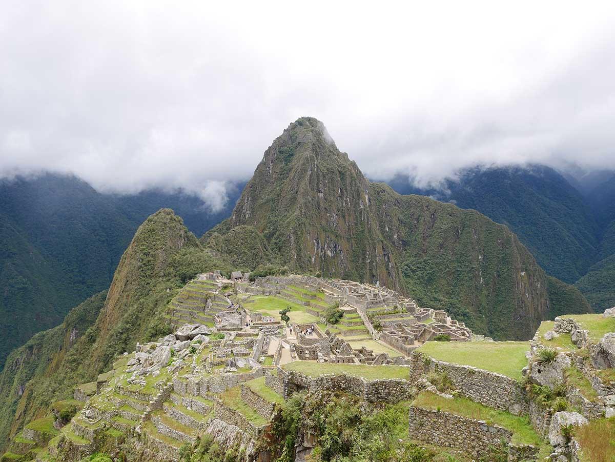 White clouds above Machu Picchu, a stone citadel in Peru.