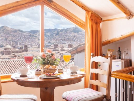 A table set for breakfast overlooking Cusco at Casa San Blas Boutique Hotel.