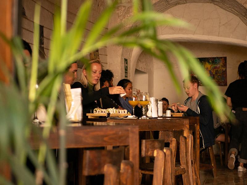 Interior shot of people eating at El Buda Profano restaurant in Arequipa
