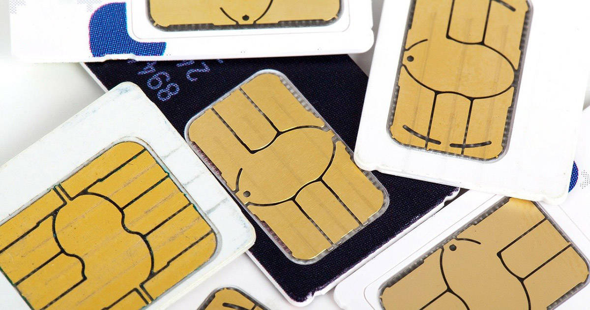 A pile of different sim cards for cell phones.