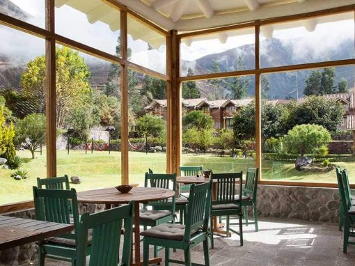 Inside Alma Restaurant overlooking the Andean scenery through floor-to-ceiling windows.