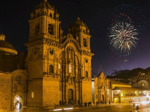 Cusco Plaza de Armas with a Firework in the night sky during the holiday season.