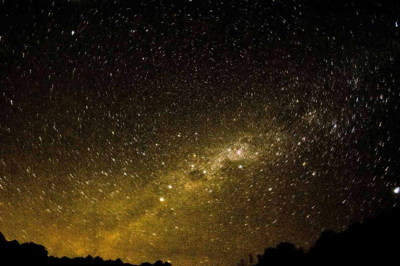 Yellow and white stars light up the dark night sky at the Pacaymayu campsite.