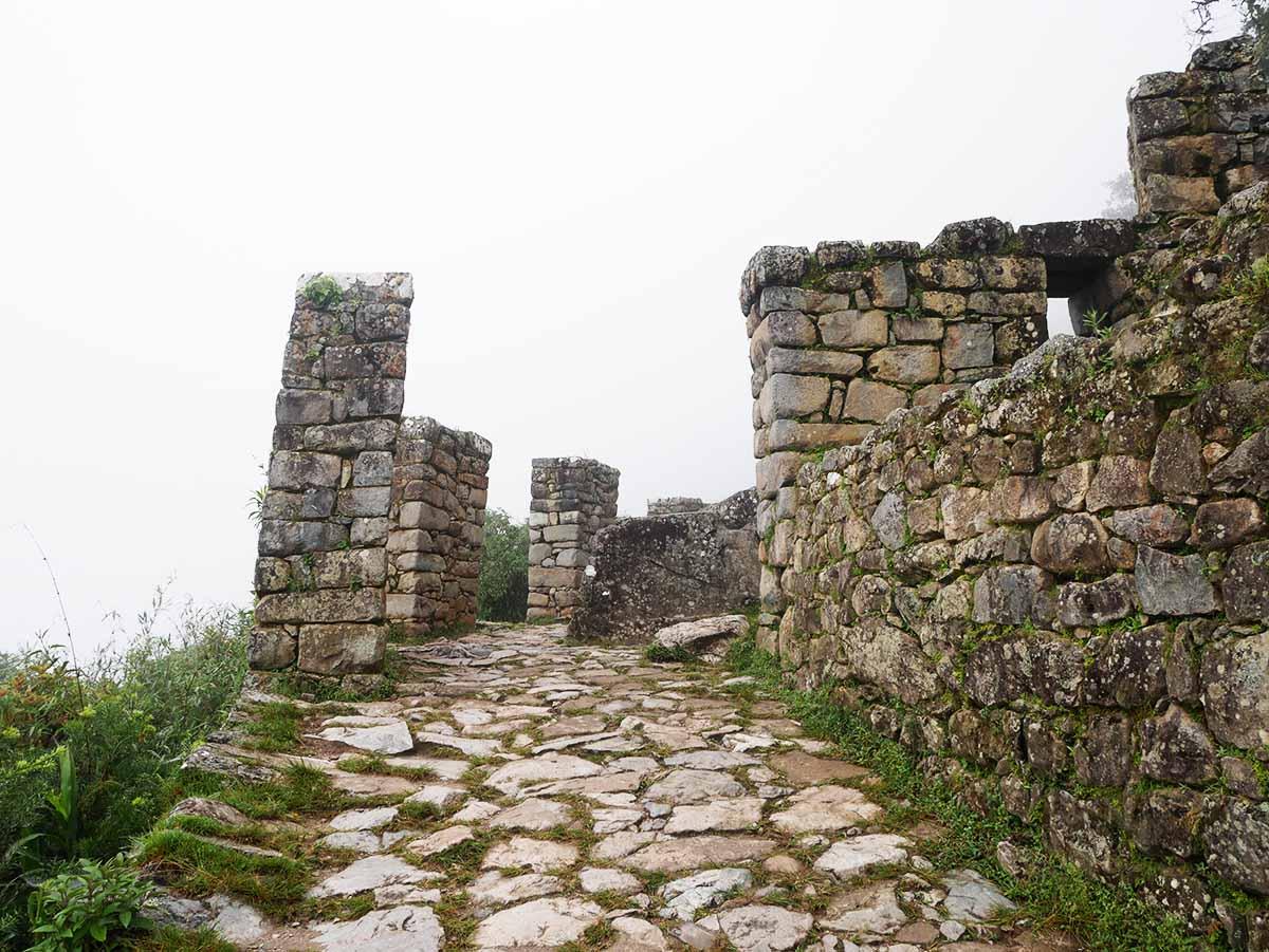 A stone walkway leads to stone walls that make up the Sun Gate, or Inti Punku, at Machu Picchu.