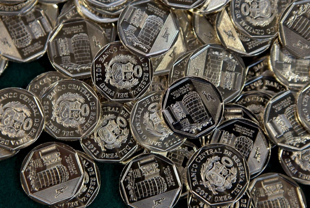 a close up of Peruvian coins