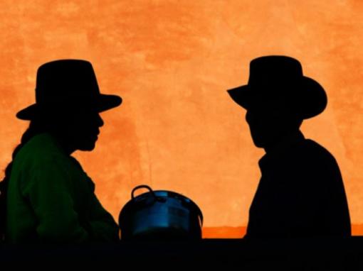 A silhouette of a native Peruvian couple.