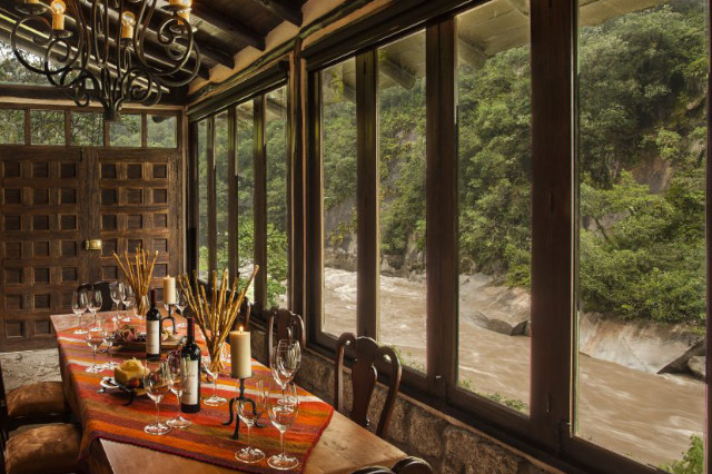 Dining room and wine cellar combo overlooking the river at Inkaterra el Pueblo