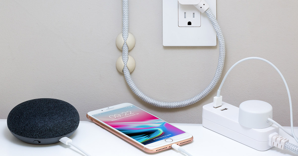 iPhone and other electrical devices plugged into electrical outlet