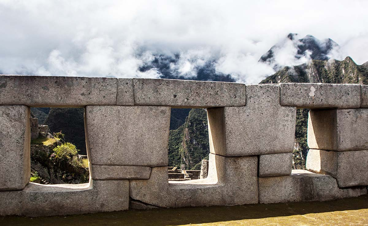 The Incan temple of the three windows with a trapezoidal structure typical of Incan architecture.