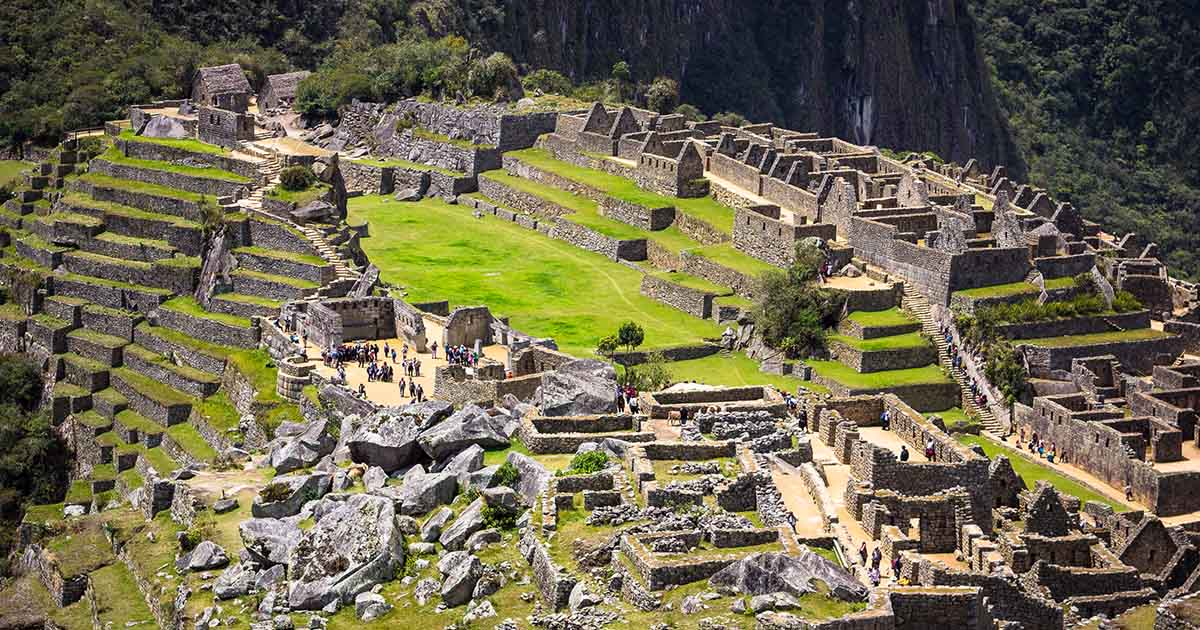 An aerial view of the Machu Picchu ruins on a bright, sunny day.