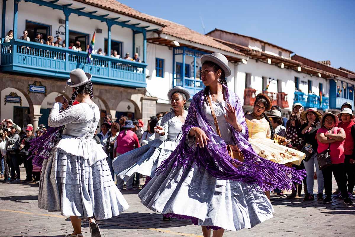 Quechua women dancing in the main plaza of Cusco.