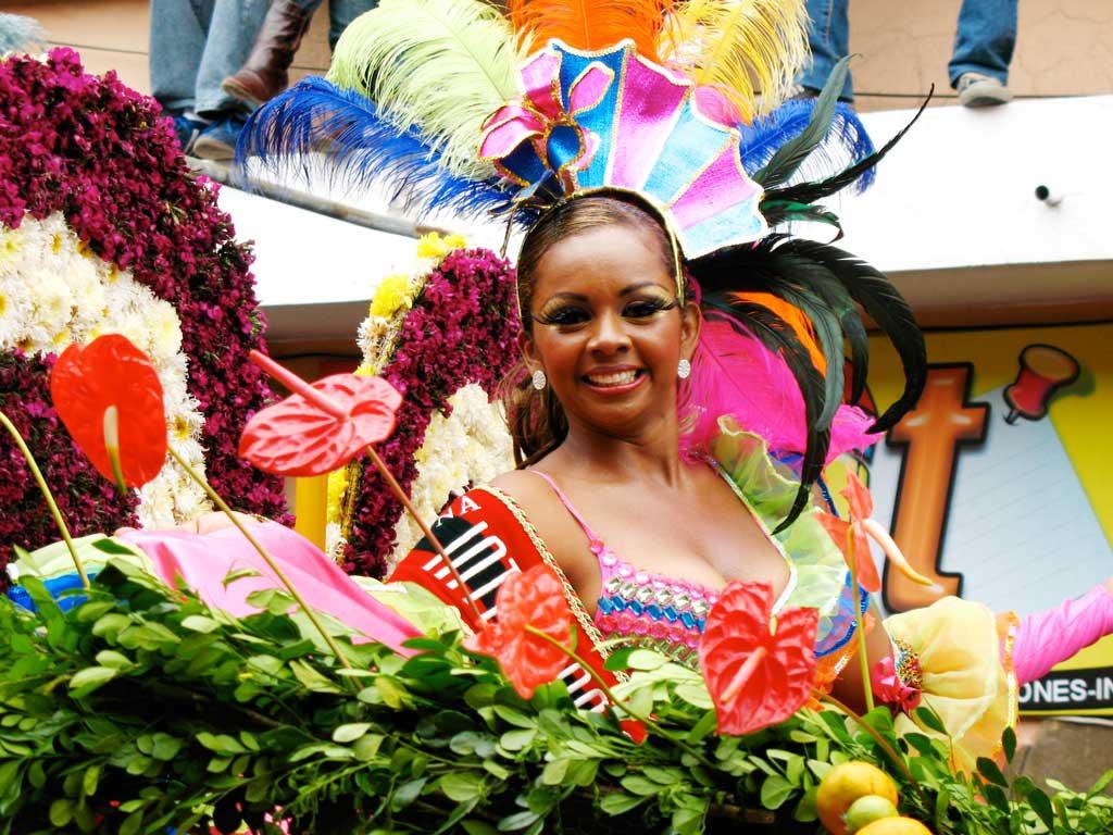 Woman in colorful traditional costume in carnival in Ambato Ecuador.