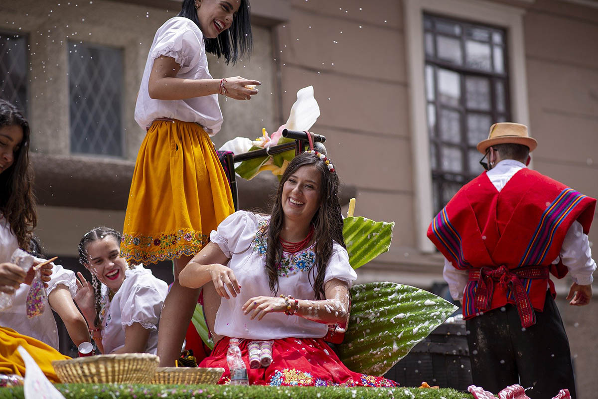 Women in traditional attire during a parade during Carnival festivities.