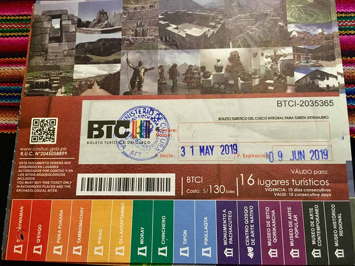 The Cusco Tourist ticket is a rainbow colored ticket giving entry to multiple famous landmarks in Peru