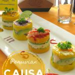 3 small yellow potato cakes with different toppings on a rectangular plate