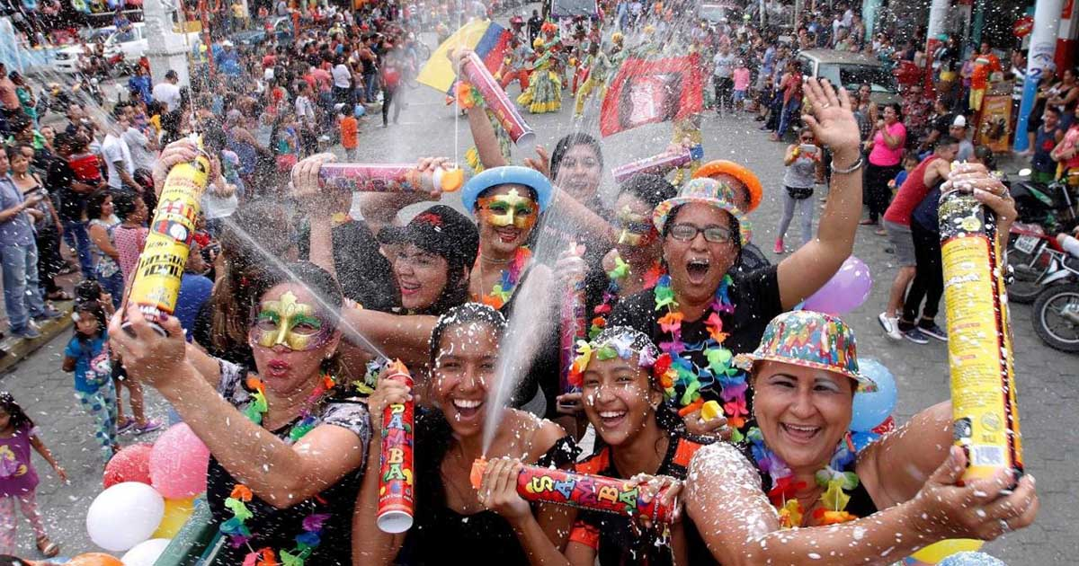 Group of festival goers with spray foam at Carnaval in Ecuador