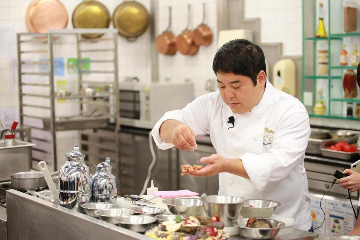 Famous Nikkei restaurant Maido's Chef Mitsuharu preparing food in his restaurant's kitchen.