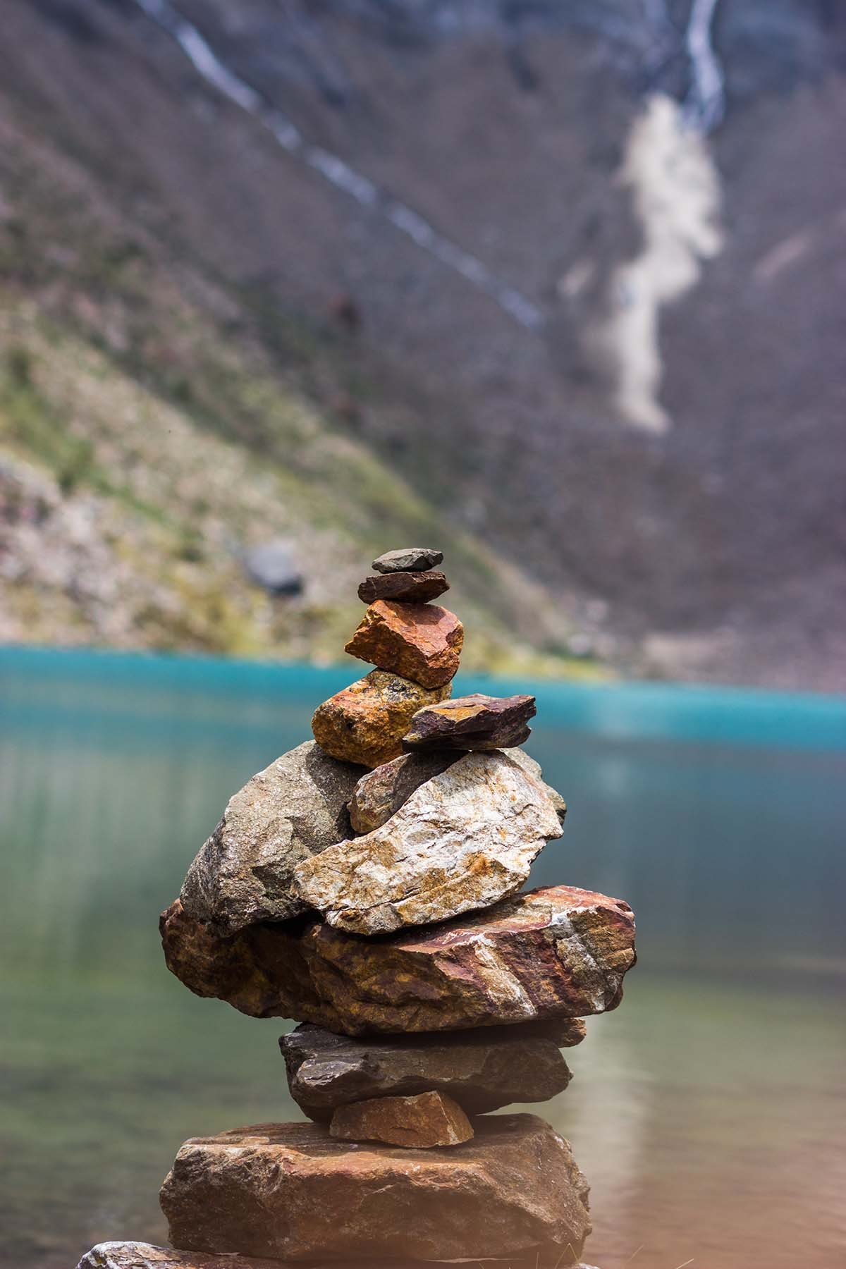 "A stack of flat rocks make an ""hito de piedra"" along the shores of Lake Humantay near Cusco."