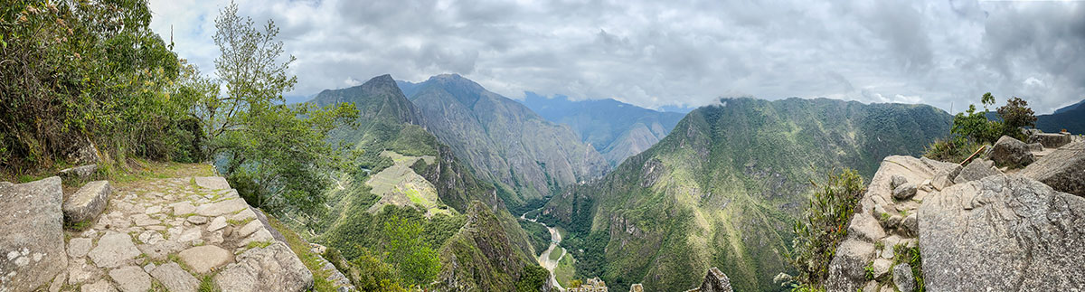 A panoramic view from the Huayna Picchu summit of the mountains and ruins below.
