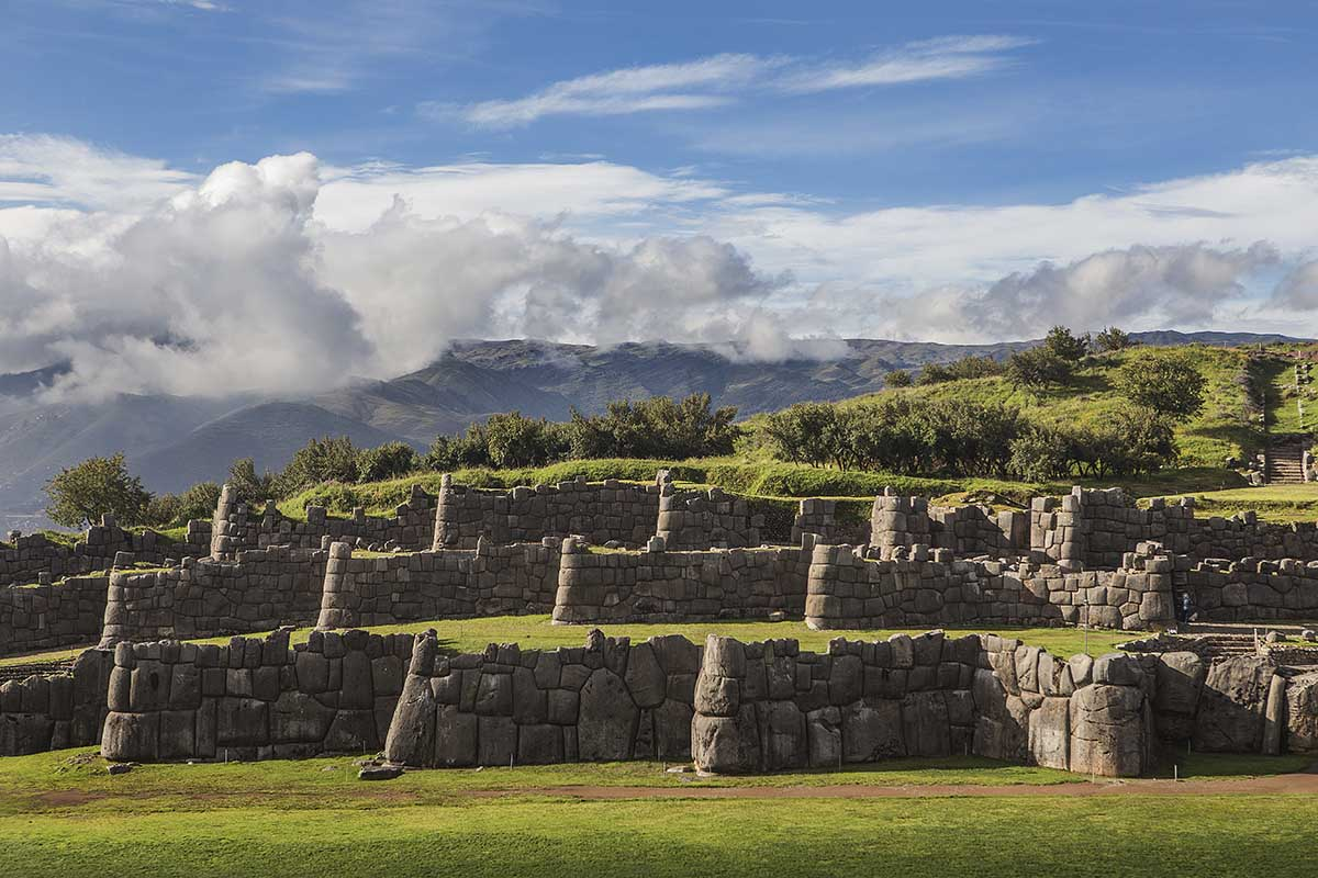A sunny day view of the zig-zagging Inca walls of Sacsayhuaman.