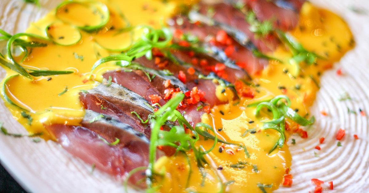 Plated tiradito de pescado, a classic Japanese Peruvian seafood dish.