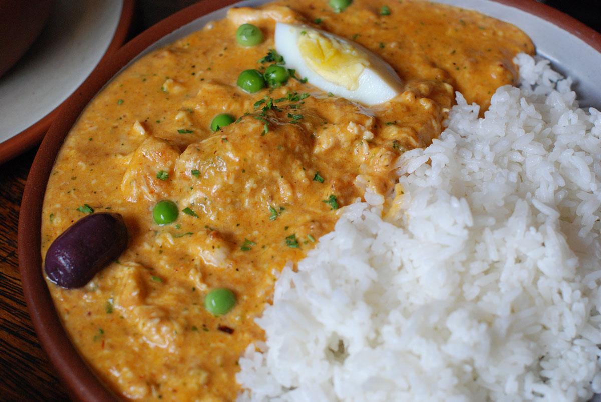 Popular Peruvian dish, aji de gallina, served with white rice.